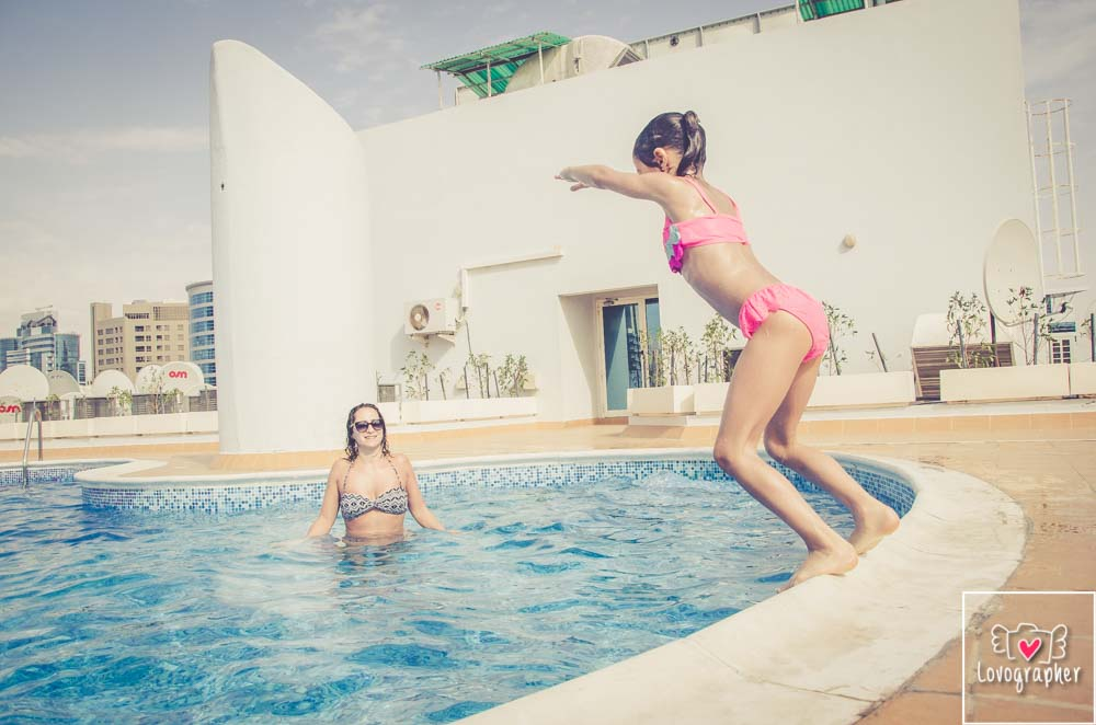 Personal Photographer - Family at the pool with private photographer in Dubai